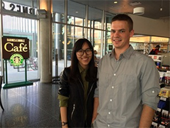 Michael Buening standing with his research partner Wanyi Huang.