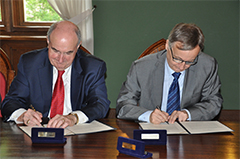 McRobbie signing an agreement.