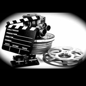 Black and white photo of film canisters and movie camera.